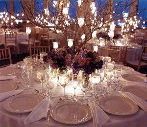 Branches centerpieces with hanging lanterns