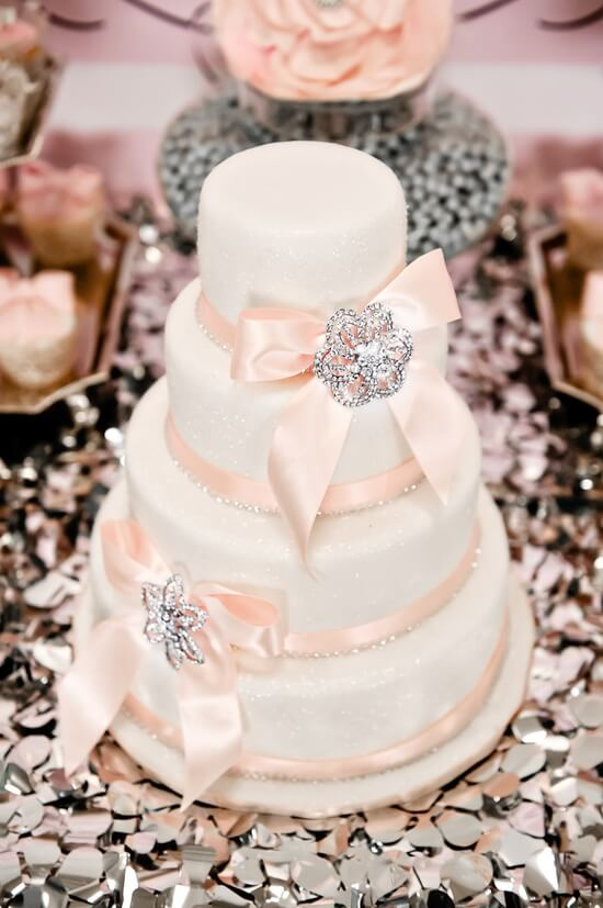 White wedding cake with broach crystals