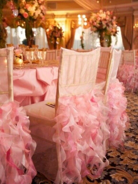 Pink ruffled chair back cover