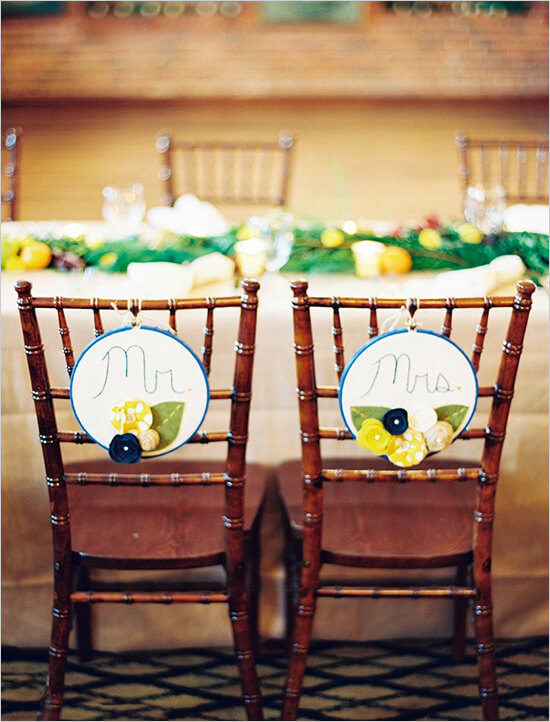 Wedding chair back decorations for bride and groom at spring wedding reception.