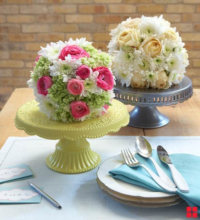 Flower arangements on cake stands centerpieces