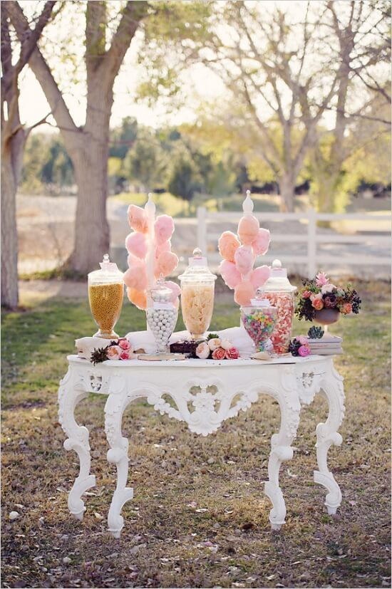 Vintage candy buffet table at outdoor wedding reception