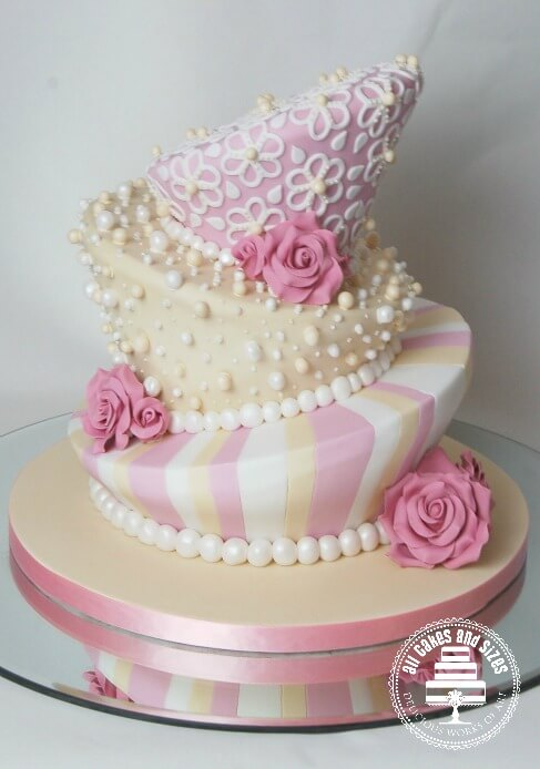 Small pink and white wedding cake -lopsided design.