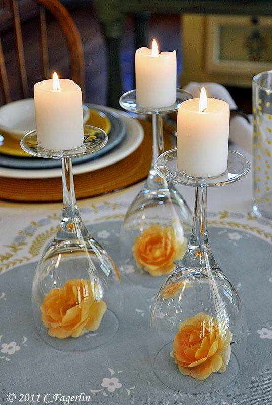 Upside down wine glasses used as candle holders for wedding centerpiece