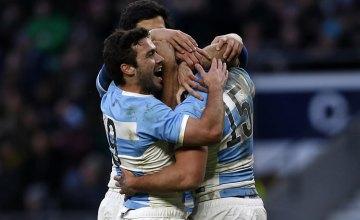 Argentinas Full Back Ramiro Moyano (R) celebrates scoring at Twickenham