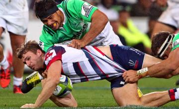om Shipperley of the Rebels is tackled by Shane Christie
