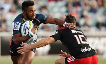 Henry Speight fends off a tackle for the Brumbies against the Crusaders