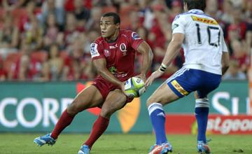 Will Genia clears the ball for the Reds against the Stormers