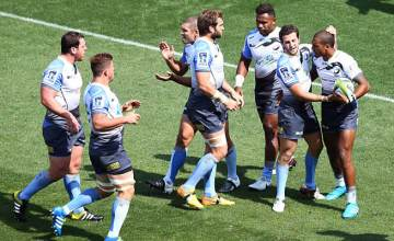 Marcel Brache celebrates a try with his team mates