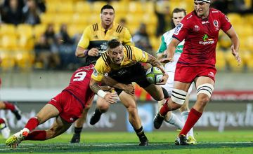 TJ Perenara is tackled by Nick Frisby
