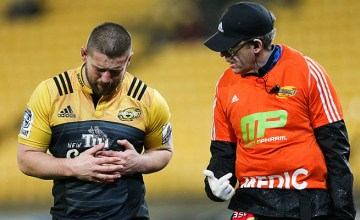 Dane Coles holds his rib cage in pain