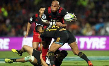 Nemani Nadolo of the Crusaders is tackled by Seta Tamanivalu of the Chiefs