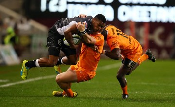 Sbura Sithole is tackled by Fred Zeilinga of the Cheetahs