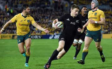 Beauden Barrett as Adam Ashley-Cooper (L) and David Pocock (R) look on