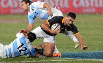 Damian de Allende is double tackled by Argentina