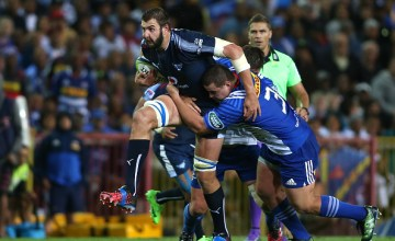 Lood de Jager of the Bulls attempts to break Wilco Louw of the Stormers