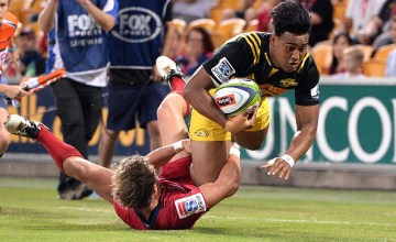 Julian Savea of the Hurricanes scores a try during the Super Rugby round six match