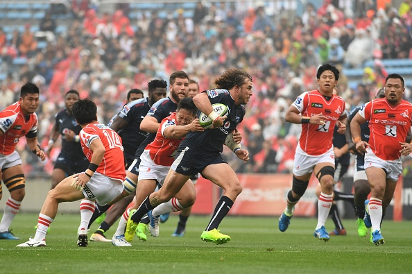 Burger Odendaal of the Bulls (C) carries the ball during the Super Rugby match between the Sunwolves