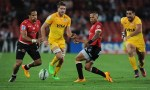 Lions' Elton Jantjies (R) and Courtnall Skosan (L) tackle Jaguares' Rodrigo Baez and Jeronimo de la Feunte during the SUPERXV