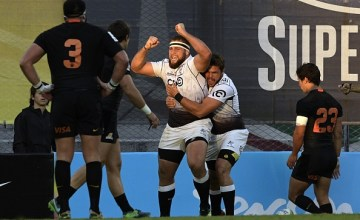 South Africa's Sharks prop Thomas du Toit (C) celebrates