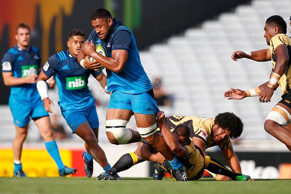 Patrick Tuipulotu of the Blues is tackled during the round six Super Rugby match