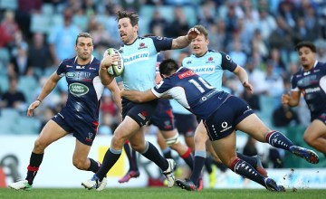 Bernard Foley of the Waratahs is tackled during the round 13 Super Rugby match between the Waratahs and the Rebels