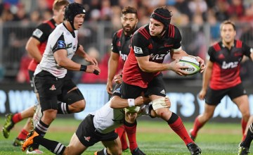 Matt Todd of the Crusaders looks to offload the Super rugby ball