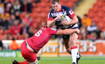 Toby Smith of the Melbourne Rebels takes on the defence during the round 17 Super Rugby match between the Reds and the Rebels at Suncorp