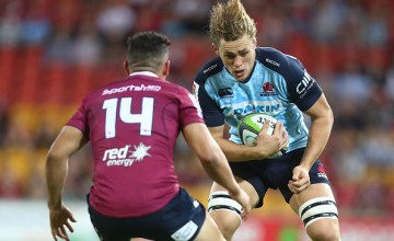 Ned Hanigan of the Waratahs runs the ball during the round 10 Super Rugby match