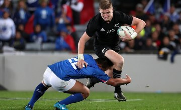 Jordie Barrett of the All Blacks (R) is tackled by D'Angelo Leuila of Samoa