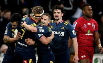 James Lentjes of the Highlanders celebrates his try with team mate Kayne Hammington during the round 17 Super Rugby match between the Highlanders and the Reds