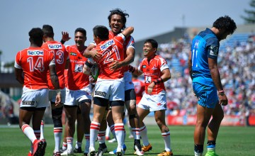 Kaito Shigeno #21 of Sunwolves celebrates scoring a try with his teammates during the Super Rugby match between the Sunwolves and the Blues at Prince Chichibu Stadium