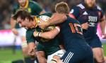 Eben Etzebeth of the Springboks tackled by Jules Plisson of France
