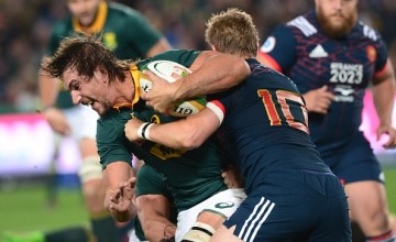 Eben Etzebeth of the Springboks tackled by Jules Plisson of France
