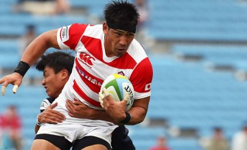Ryoto Nakamura #10 of Japan runs with the ball during the Asia Rugby Championship match between Japan and Hong Kong at Prince Chichibu Stadium on May 27, 2016 in Tokyo, Japan.