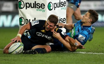 Teihorangi Walden of the Highlanders dives over to score a Super Rugby try in the tackle of Matt Duffie