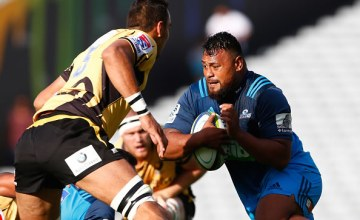 Pauliasi Manu of the Blues is tackled during the round six Super Rugby match