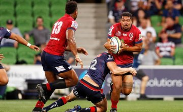 Chris Feauai-Sautia of the Reds is tackled by Reece Hodge of the Rebels during the round two Super Rugby match between the Melbourne Rebels and the Queensland Reds