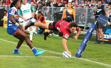 George Bridge of the Crusaders dives over to score a try during the round two Super Rugby match between the Crusaders and the Stormers