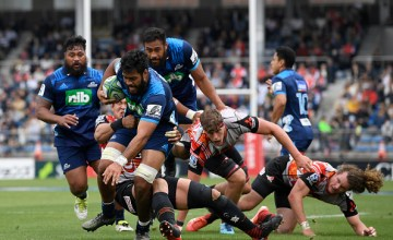Akira Ioane No 8 of Blues runs with the ball during during the Super Rugby Round 9 match