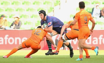 Ross Haylett-Petty of the Rebals is tackled by Jeronimo De la Fuente of the Jaguares during the round nine Super Rugby match between the Rebels and the Jaguares