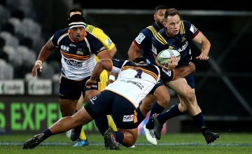 Ben Smith of the Highlanders is tackled by Scott Sio of the Brumbies during the round nine Super Rugby match between the Highlanders and the Brumbies at Forsyth Barr Stadium