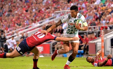Solomon Alaimalo of the Chiefs breaks away from the defence during the round 10 Super Rugby match between the Reds and the Chiefs at Suncorp Stadium