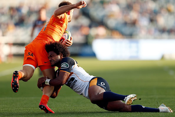 Henry Speight of the Brumbies makes a tackle on Guido Petti of the Jaguares during the round 10 Super Rugby match between the Brumbies and the Jaguares