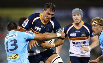 Rory Arnold of the Brumbies is tackled during the round seven Super Rugby matc