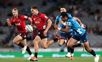George Bridge of the Crusaders makes a break during the Super Rugby match between the Blues and the Crusaders at Eden Park