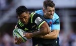 Vince Aso of the Hurricanes is tackled by Bernard Foley of the Waratahs during the round one Super Rugby match between the Waratahs and the Hurricanes