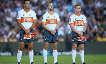 (L-R) Referees Ben O'Keeffe, Angus Gardner and Damon Murphy observe a moments silence i