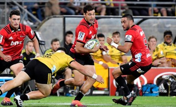David Havili scored twice as the Crusaders beat the Hurricanes in Wellington to go top of the Super Rugby table