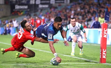 Rieko Ioane beats Phil Burleigh to the corner as the Blues beat the Sunwolves in North Harbour